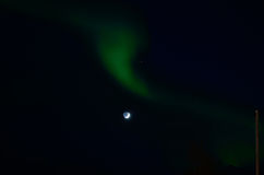 Majestic aurora borealis dancing around full moon Stock Images