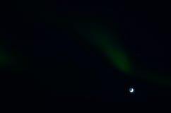 Majestic aurora borealis dancing around full moon Royalty Free Stock Image