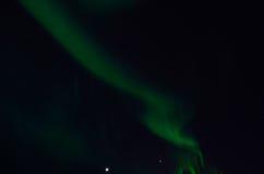 Majestic aurora borealis on dark star filled night sky Stock Photography
