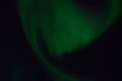 Majestic aurora borealis on dark star filled night sky Stock Photos