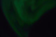 Majestic aurora borealis on dark star filled night sky Stock Image