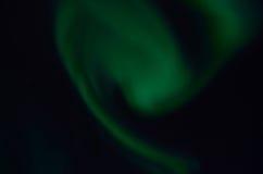 Majestic aurora borealis on dark star filled night sky Stock Images