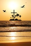 Majestic beach with island & cross in the horizon Stock Photos