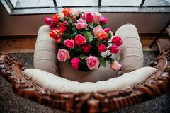 Majestic bouquet over a chair in close stock images