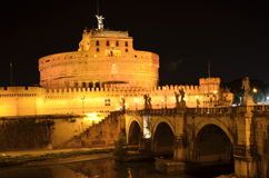 Majestic Castle of Saint  Angel over the Tiber river by night in Rome, Italy Stock Photos