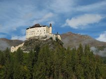 Majestic Castle Tarasp. Forest and mountain Royalty Free Stock Images