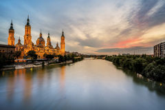 Cathedral at Sunset, Zaragoza, Spain. The majestic cathedral of the Our Lady of the Pilar in Zaragoza taken at sunset over the Ebro river Stock Photography