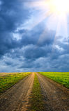 Majestic clouded sky with sun beams Royalty Free Stock Photography