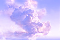 Majestic clouds in the atmosphere. Dramatic clouds in the atmosphere with beautiful pastel lavender, purple, pink and blue colors and lighting from sunrise (or Royalty Free Stock Photos