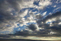 Majestic Clouds. Majestic formations white gray dark clouds blue sky Royalty Free Stock Photos