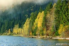 Majestic colorful autumn forest and landscape,Saint Anna Lake,Transylvania,Romania. Beautiful foggy autumn landscape,Saint Anna Lake,Transylvania,Romania,Europe Stock Photography