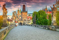 Spectacular medieval stone Charles bridge with statues, Prague, Czech Republic. Majestic colorful sunrise, spectacular morning cityscape with old stone Charles Stock Photos