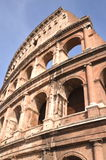 Majestic Colosseum in Rome against blue sky, Italy Royalty Free Stock Photography