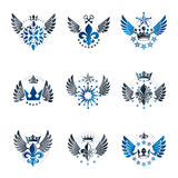 Majestic Crowns and Ancient Stars emblems set. Heraldic Coat of. Arms decorative logos isolated vector illustrations collection Stock Images
