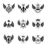 Majestic Crowns and Ancient Stars emblems set. Heraldic Coat of. Arms decorative logos isolated vector illustrations collection Stock Image