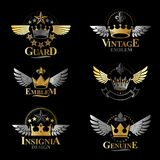 Majestic Crowns emblems set. Heraldic Coat of Arms decorative lo. Gos isolated vector illustrations collection Royalty Free Stock Images