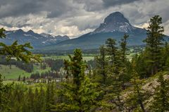 Majestic Crowsnest mountain in Southern Canada from Blairmore Rainbow falls viewpoint. Canadian dream, cloudy day - best for little walk stock photography