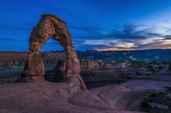 Majestic Delicate arch. Delicate Arch against cool evening sky - Moab Utah Royalty Free Stock Photos