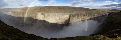 Majestic Dettifoss waterfall with rainbaw Stock Photos