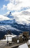 Majestic Dreamy View of snowy Gornergrat station and the iconic Matterhorn Peak shrouded with clouds, Zermatt, Switzerland, Europe Stock Photos