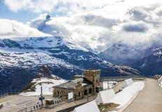Majestic Dreamy View of snowy Gornergrat station and the iconic Matterhorn Peak shrouded with clouds, Zermatt, Switzerland, Europe Royalty Free Stock Photo