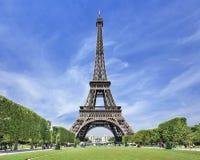 Majestic Eiffel tower in Paris against a blue sky, Paris. The majestic Eiffel tower in Paris against a blue sky, Paris, France Stock Images
