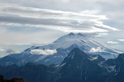 Majestic Elbrus. Elbrus mountain peak, surrounded by fog, clouds and other signs of upcoming bad weather Stock Photos