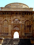 Majestic Entrance. A majestic entrance with traditional carvings, leading to a for in India Stock Photography