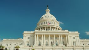 The majestic famous Capitol building in Washington, DC. Against the background of the blue sky. 4K RroRes HQ 10 bit. The majestic famous Capitol building in stock footage