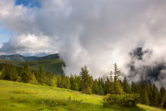 Majestic fog and clouds in the  Mountain valley landscape - gree Royalty Free Stock Photo