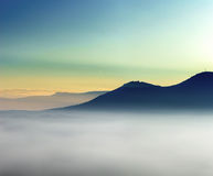 Majestic fog ocean in the mountains on sunset Stock Photo