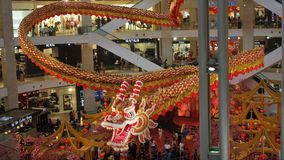 Majestic 600-ft long dragon display at Pavilion Kuala Lumpur Malaysia. `dragon chasing the pearl`  The Year of Dragon 2012 Chinese New Year red orange royalty free stock image