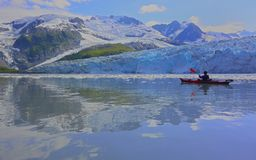 Majestic glacier and kayaker reflection Royalty Free Stock Photos