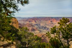 Majestic Grand Canyon, Arizona, United States. Valley with mountains with green trees and cloudy sky in Grand Canyon, Arizona, United States Royalty Free Stock Photography
