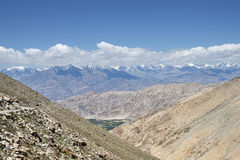 Majestic Himalayas view with green valley and winding road Royalty Free Stock Photos