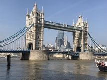 The majestic and historic London Bridge on the river Thames. View of the London Bridge over the Thames and the London skyline royalty free stock photo