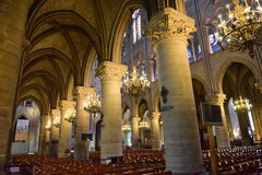 Majestic interior of the famous Notre Dame de Paris Cathedral in Paris Stock Image