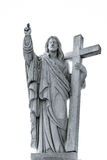 Majestic Jesus Christ sculpture over little french village Stock Image