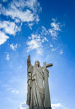 Majestic Jesus Christ sculpture over little french village Royalty Free Stock Image