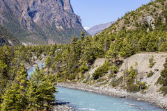 Majestic landscape and blue river in Himalayas mountains in Nepal Royalty Free Stock Images