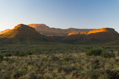 Majestic landscape at Karoo National Park, South Africa. Scenic table mountains, canyons and cliffs at sunset. Adventure and explo Stock Images