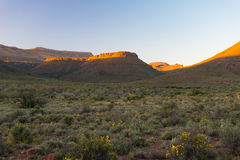 Majestic landscape at Karoo National Park, South Africa. Scenic table mountains, canyons and cliffs at sunset. Adventure and explo Stock Photography