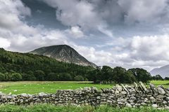 Majestic landscape of Lake District,Cumbria,Uk. Majestic landscape of rural Lake District, Cumbria,UK.Stone wall on pasture, trees growing on hill slope and royalty free stock images