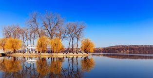 Majestic landscape. man-made island in the middle of the lake in the city is reflected in water. Beautiful morning views. people relaxing on fishing. Beauty in Royalty Free Stock Images