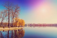 Majestic landscape. man-made island in the middle of the lake in the city is reflected in water. Beautiful morning views. people relaxing on fishing. Beauty in Stock Photography