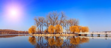 Majestic landscape. man-made island in the middle of the lake in the city is reflected in water. Beautiful morning views. people relaxing on fishing. Beauty in Stock Image
