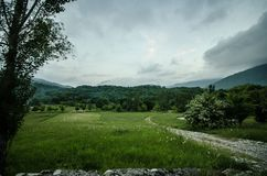 Majestic landscape of mountains and Meadow. Cycling mountain road. Misty mountain road in high mountains.. Cloudy sky with mountai. N road. Azerbaijan nature Royalty Free Stock Image