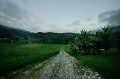 Majestic landscape of mountains and Meadow. Cycling mountain road. Misty mountain road in high mountains.. Cloudy sky with mountai. N road. Azerbaijan nature Royalty Free Stock Photography