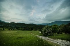 Majestic landscape of mountains and Meadow. Cycling mountain road. Misty mountain road in high mountains.. Cloudy sky with mountai. N road. Azerbaijan nature Stock Images