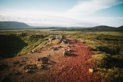 Majestic landscape with red ground, rocks and grass at sunny. Day, iceland royalty free stock photos